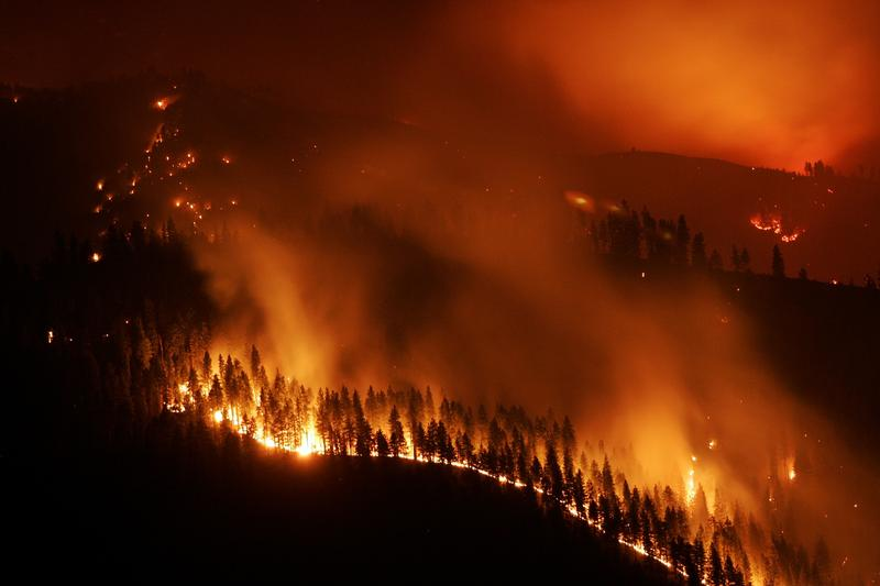 The Blackerby Fire burns along a ridge after midnight Saturday, Aug. 13, 2005 near Grangeville, Idaho.