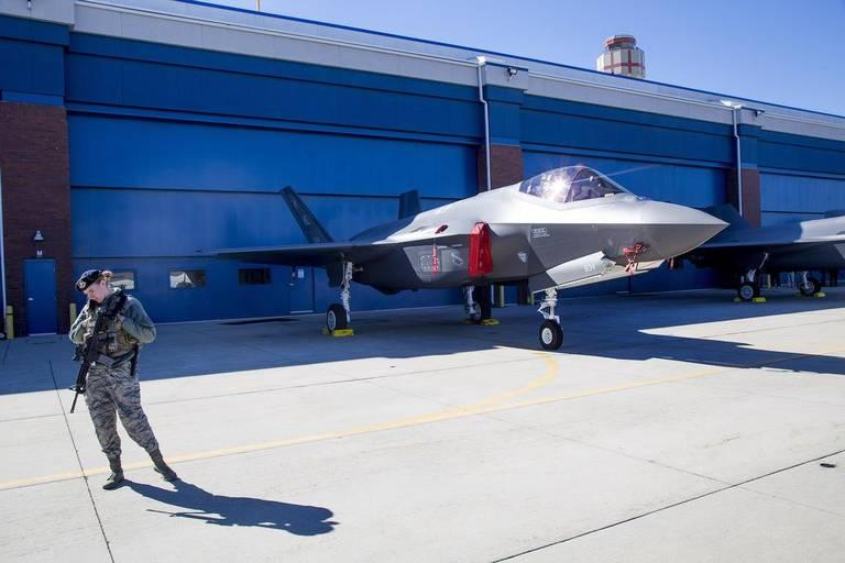 A guard stays close to a F-35 fighter at Gowen Field during the Boise air show in October.