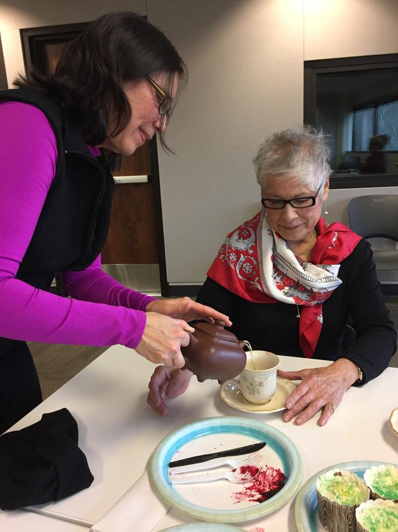 Boise State Professor Pei-Lin Yu pours oolong tea from her family's decades old teapot into stylist Ruth Romero's cup. Along with cupcakes and tea, crumpets and jam were a part of the spread.