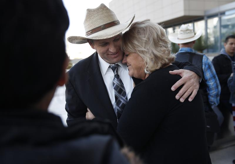 Ammon Bundy, left, hugs is aunt Lillie Spencer outside of a federal courthouse Wednesday, Dec. 20, 2017, in Las Vegas.