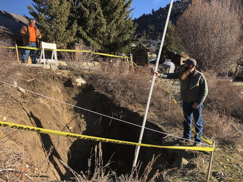 Phil Barbarick (left) and Heavy Equipment Operator Adam R. Nelson with Idaho BLM take measurements of the collapsed mine shaft.