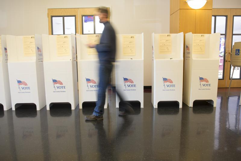 A man leaves the voting booths after voting in the GOP primary election in Boise on Tuesday, March 8, 2016.