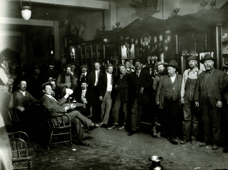 A bar in Nampa in 1926. The man in the foreground, seated with cards in hand, is Harvey Moore.