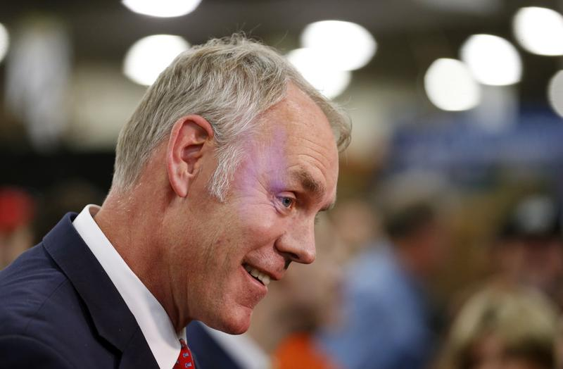 In this Feb. 9, 2018, file photo, U.S. Interior Secretary Ryan Zinke speaks to reporters at a conservation announcement at the Western Conservation and Hunting Expo in Salt Lake City.