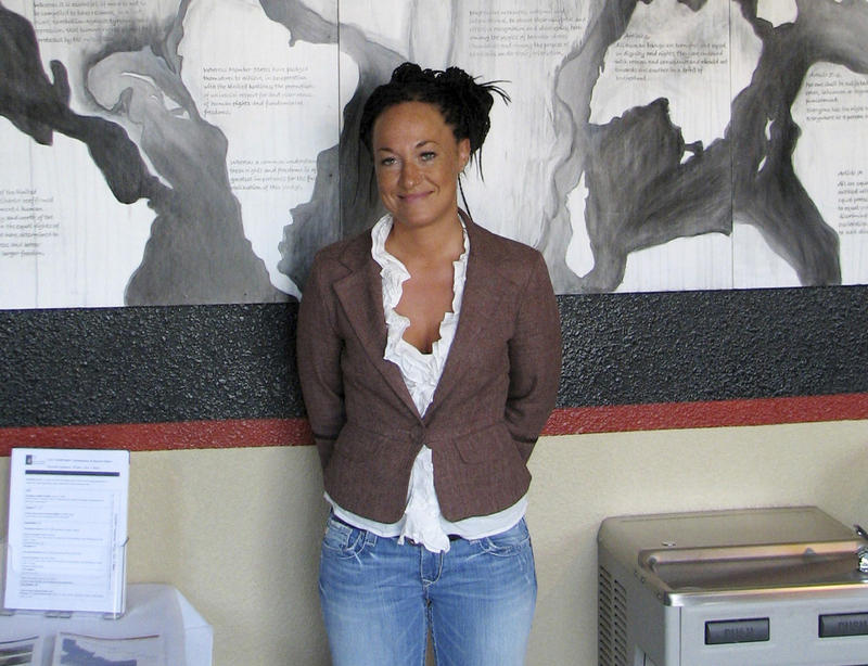 In this July 24, 2009, file photo, Rachel Dolezal, then head of the Human Rights Education Institute, stands in front of a mural she painted at the institute's offices in Coeur d'Alene, Idaho.
