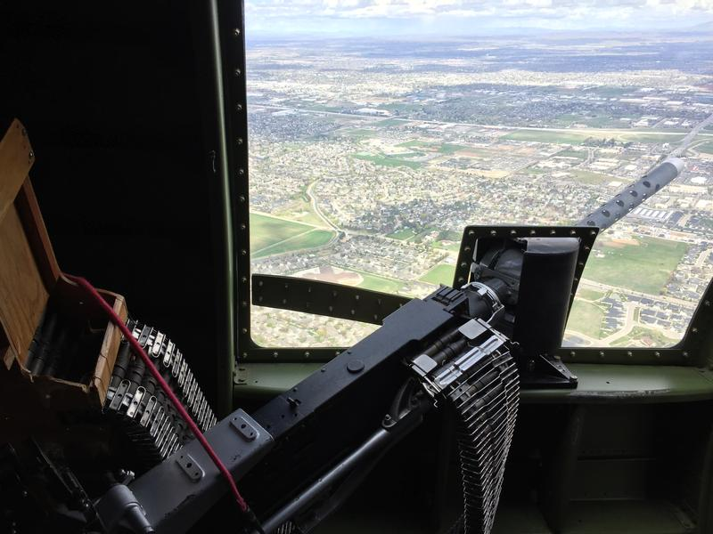 """Flying over the Treasure Valley, the view from the waist gun of the """"Madras Maiden"""" allows those aboard to pretend they're defending the aircraft from enemy fire."""