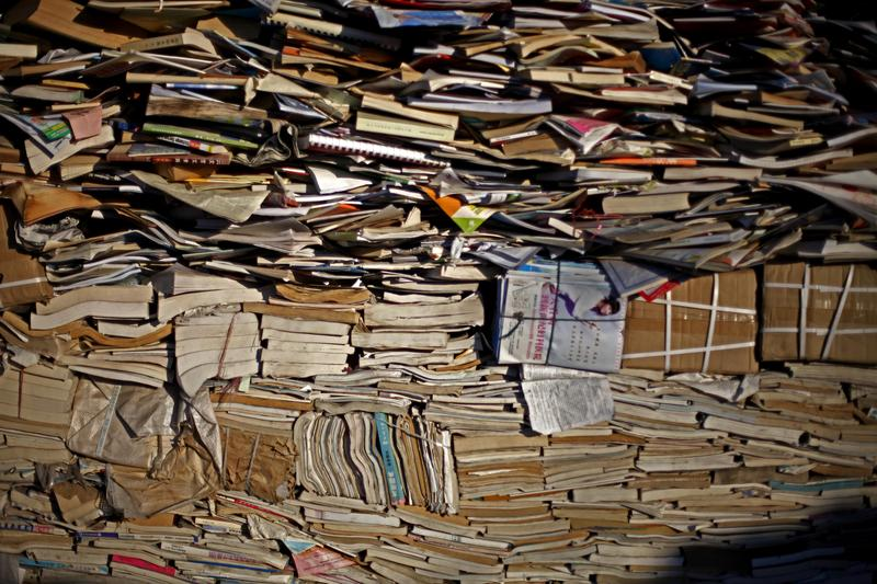 Books and paper ready for processing sit at a recycling center in Beijing, China, Tuesday, Dec. 15, 2009.