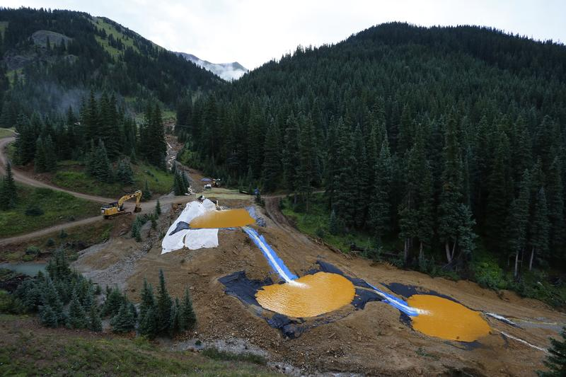 In this Aug. 12, 2015, file photo, water flows through a series of retention ponds built to contain and filter out heavy metals and chemicals from the Gold King Mine spill near Silverton, Colo.