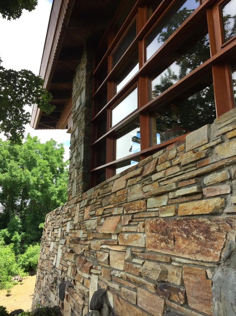 Abundant windows and masterful stonework figure prominently into the studio. The Oakley stone the structure is made from is native to Idaho was quarried about 80 miles east of the site.