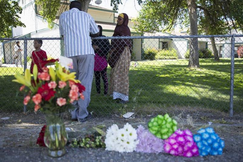 Ibod Hasn, center, talks to a friend who came to visit after the stabbing attack on Wylie Lane in Boise on Saturday night. Hasn is a refugee from Somalia, and she said seeing the blood reminded her of Somalia.