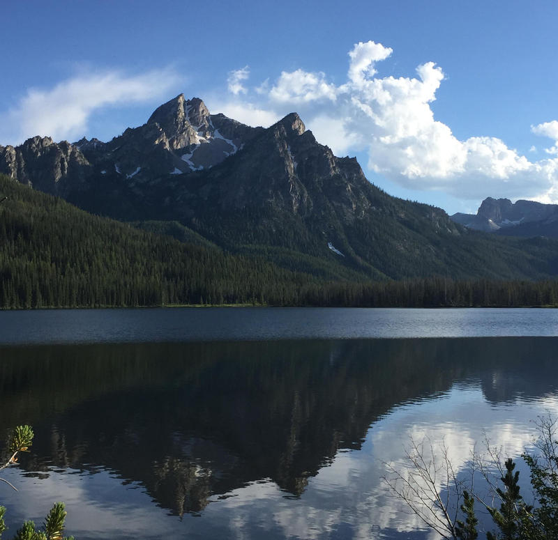 The Sawtooth Mountains loom impressively over Stanley Lake.