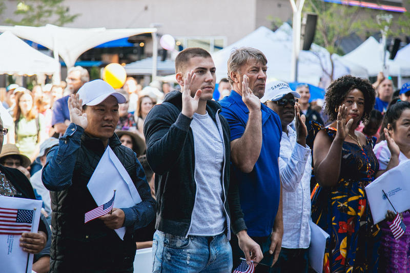 Refugees giving their Oath of Allegiance to the U.S. Saturday in downtown Boise during 2017 World Refugee Day.