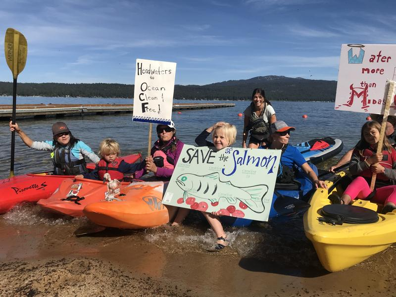 A small flotilla arrived to the protest by kayak and stand-up paddle board over Labor Day weekend. Protesters say resurrecting the Stibnite mine could cause irreparable damage to the Salmon River watershed.
