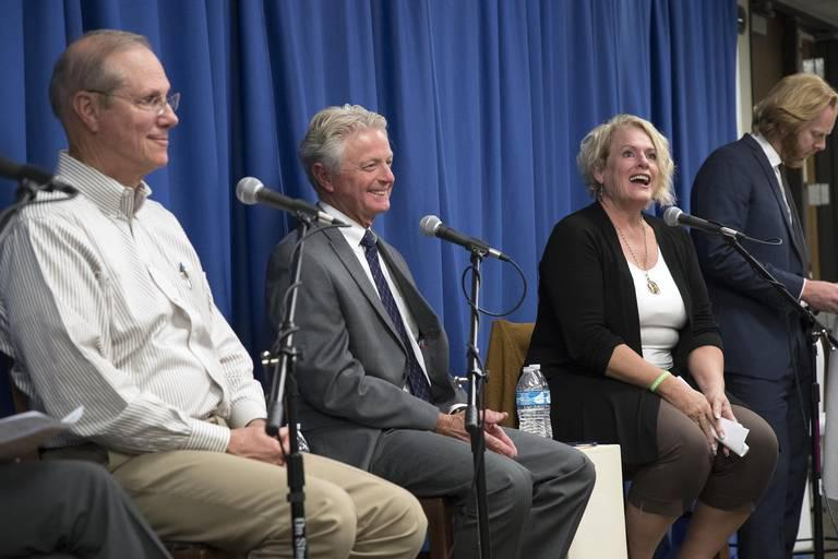 Meridian Mayor Tammy de Weerd, right, laughs with Garden City Mayor John Evans, left, and Eagle Mayor Stan Ridgeway as they tackle traffic issues during a forum with five Treasure Valley mayors Wednesday, Oct. 3, 2018 at the offices of Boise Public Radio