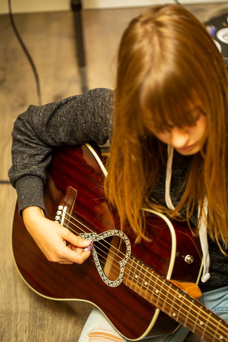 Boise Rock School student Aliyah practicing guitar.
