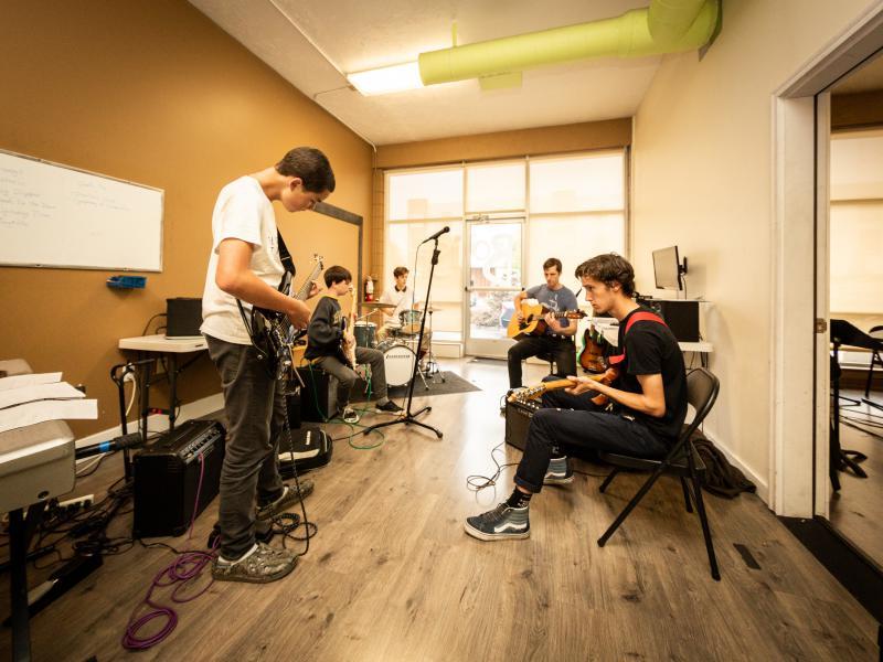 Instructor Craig Hawkins teaches a guitar session.