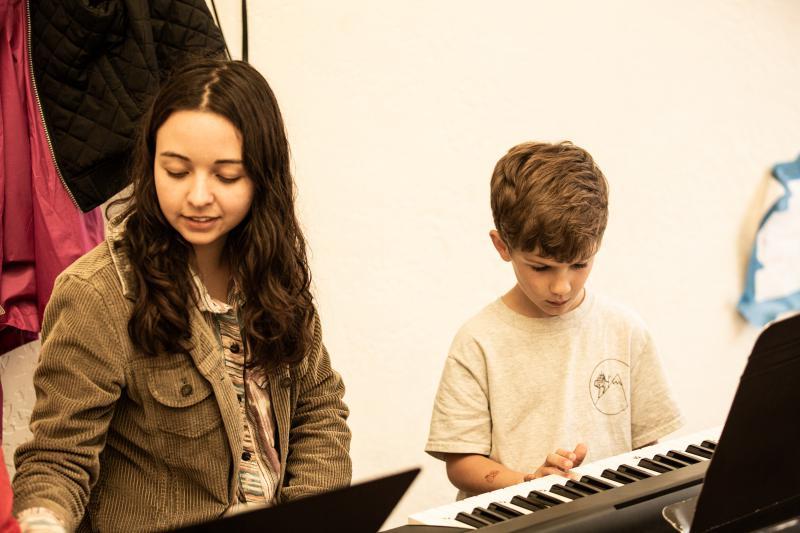 Instructor Angel Abaya and Boise Rock School student.