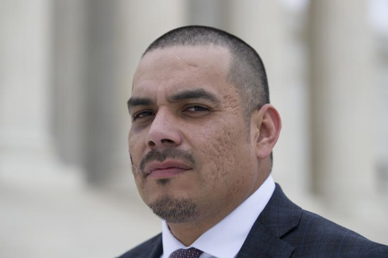 Clayvin Herrera poses for a picture on the plaza of the Supreme Court, Tuesday, Jan. 8, 2019, in Washington.