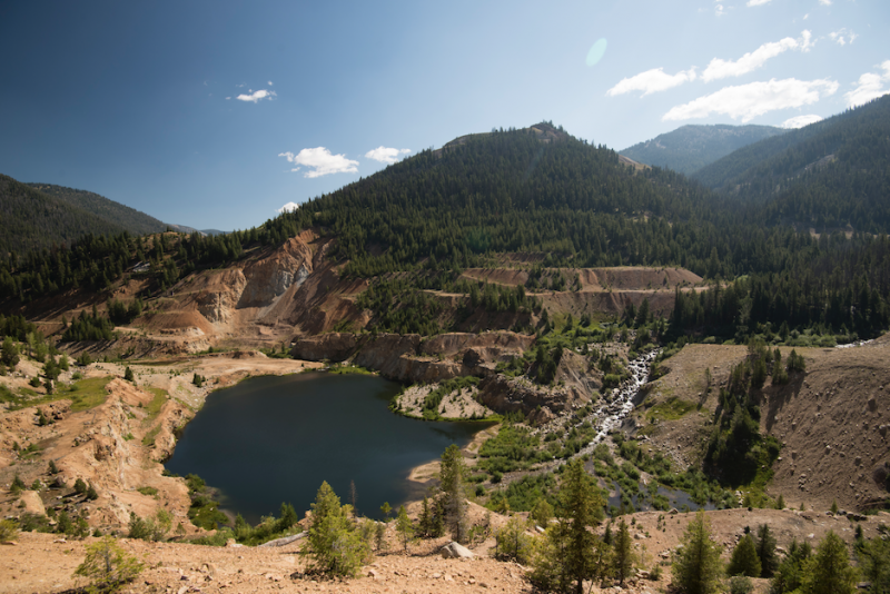 The Yellow Pine pit blocks natural passage of the East Fork of the South Fork of the Salmon River, a barrier to Chinook reaching their historic spawning grounds. It's also a source of heavy metal leaching into the river.