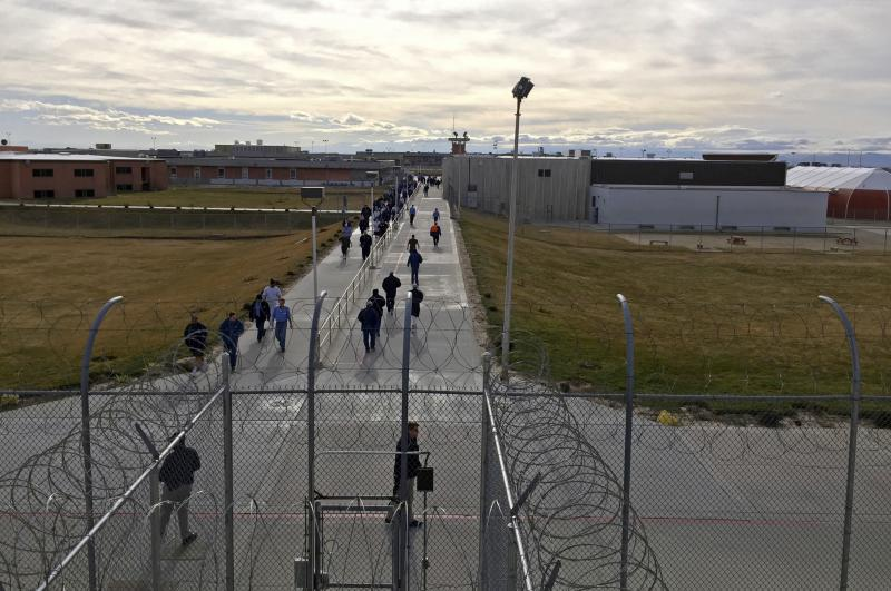 In this Jan. 30, 2018 file photo, inmates walk across the grounds of the Idaho State Correctional Institution in Kuna, Idaho. Idaho transgender inmate Adree Edmo has spent most of her prison term at this men's prison facility.