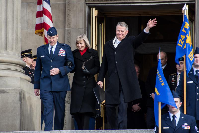 Gov. Brad Little, right, and his wife, Teresa, make their way down the Capitol steps Friday just before his ceremonial swearing in.