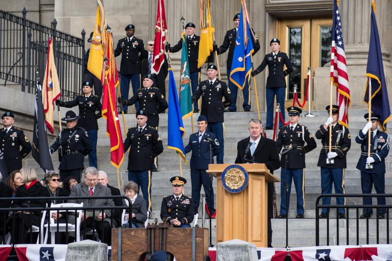 Gov. Brad Little addresses the crowd numbering in the hundreds at his inauguration Friday.