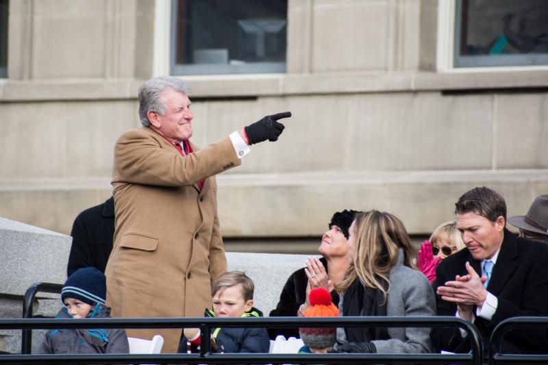 Outgoing Gov. Butch Otter points to his former lieutenant Brad Little during Friday's inauguration at the Capitol.