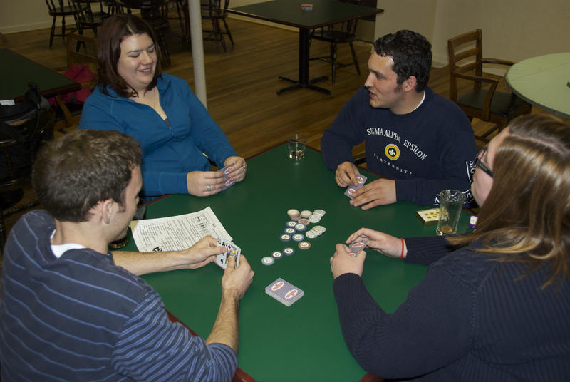 Friends play a game of mus at the Basque Center in downtown Boise.