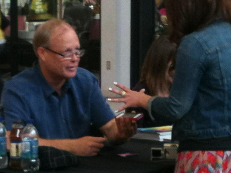 Actor Bill Fagerbakke talking with fans at the Palouse Mall Saturday
