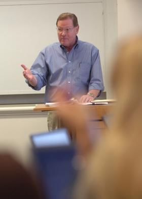 Syracuse University law professor Ted Hagelin lectures during his course on technology commercialization.