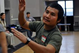 Seksan Kwanchaiwong leads a team building exercise during a job training program.