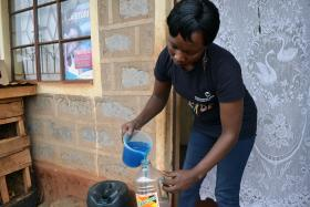 Susan Wanjiru uses used water bottles to sell her homemade soaps.