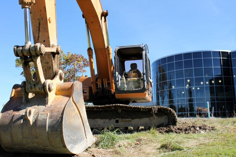 No golden shovels here: BU's Center for Excellence groundbreaking was so big it got a bulldozer.