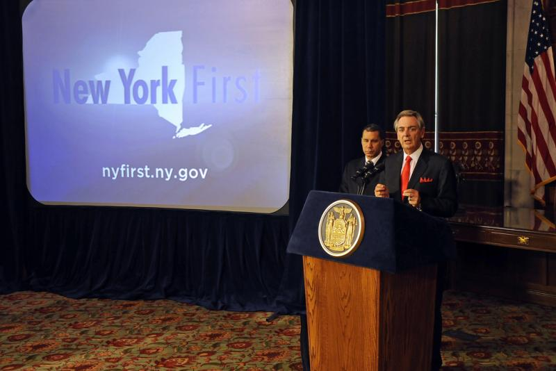 Empire State Development CEO Dennis Mullen with Governor David Paterson at a recent event. New York First is a website that encourages companies to relocate in New York State.
