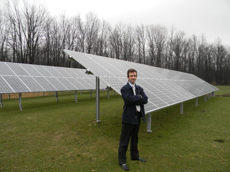 Standing next to a 25 Kw solar array, Daniel Montante says the installation will power up to 75 percent of the energy needs of a building at Riverview Solar Technology Park.