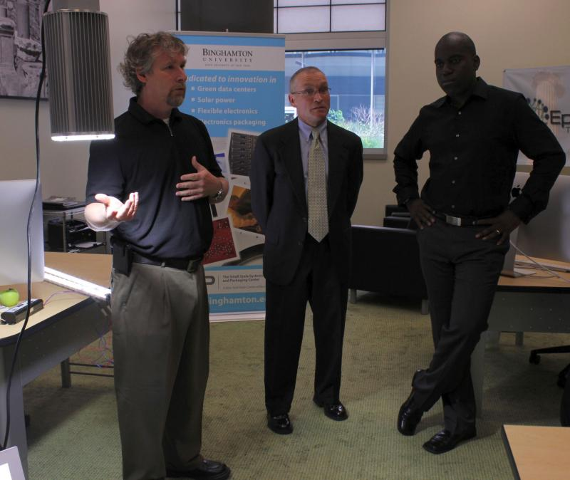 The three CEOs, right to left: Felix Ejeckam, Joe Casper, and John Johnston - and their light.