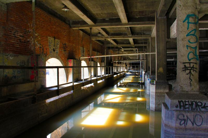 The Erie Canal-era Johnson Seymour Mill Race, above, flows underneath Rochester's central library. The City of Rochester wants to put it back to work - via a new clean energy project.