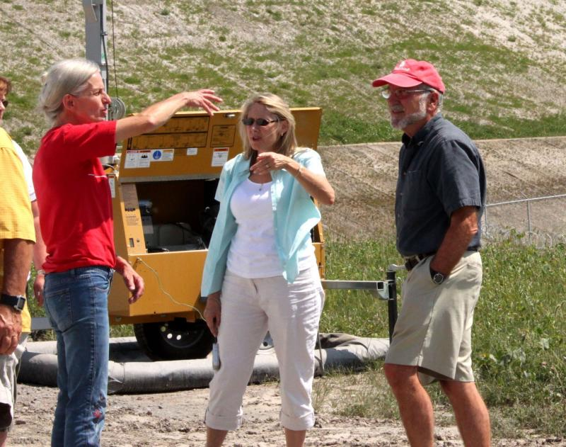 "Tompkins County legislator Carol Chock (center) visits a Pennsylvania drilling site to learn how the industry affects communities.  One year later, she says she had ""no clue"" how much work preparing for fracking would be."