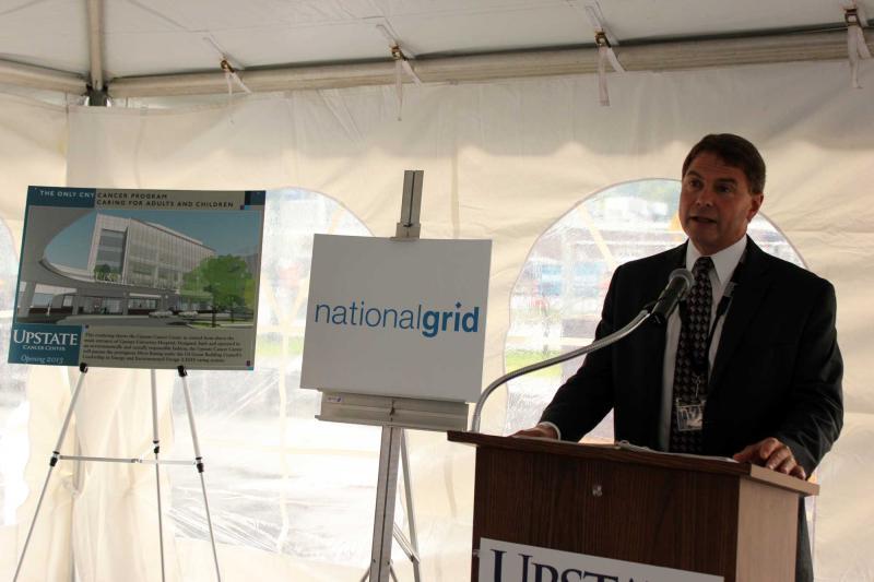 Tom Pelis of Upstate University Hospital presents drawings of planned facilities for Syracuse's University Hill neighborhood.
