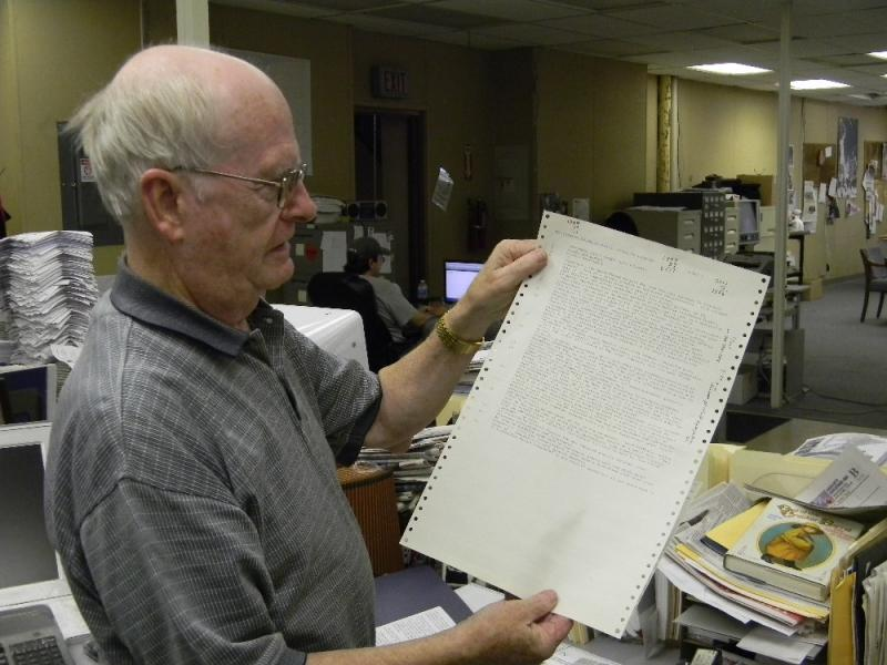 Don Glynn of the Niagara Gazette holds up his article on Governor Cuomo's regional councils ... that he wrote 27 years ago.