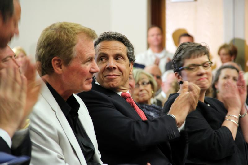Governor Andrew Cuomo flanked by Finger Lakes Council co-chair Danny Wegman (left) and council member Anne Kress (right) at the council's kick-off announcement in July.