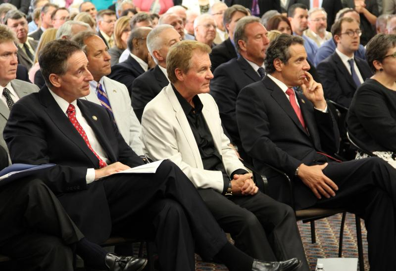 Lt. Gov. Robert Duffy, Finger Lakes regional co-chair Danny Wegman and Governor Andrew Cuomo listening to details at the Finger Lakes Regional Economic Development Council kickoff event in July.