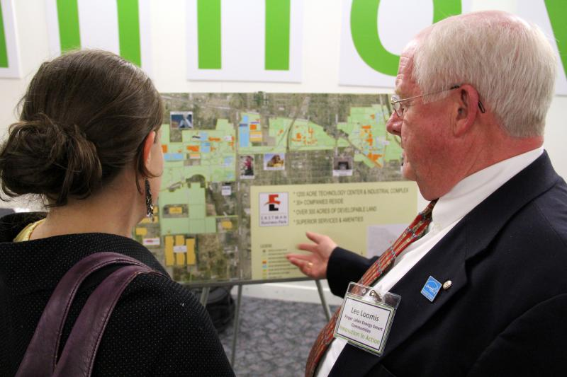 Attendees study a map of Eastman Business Park at Tuesday's innovation forum.