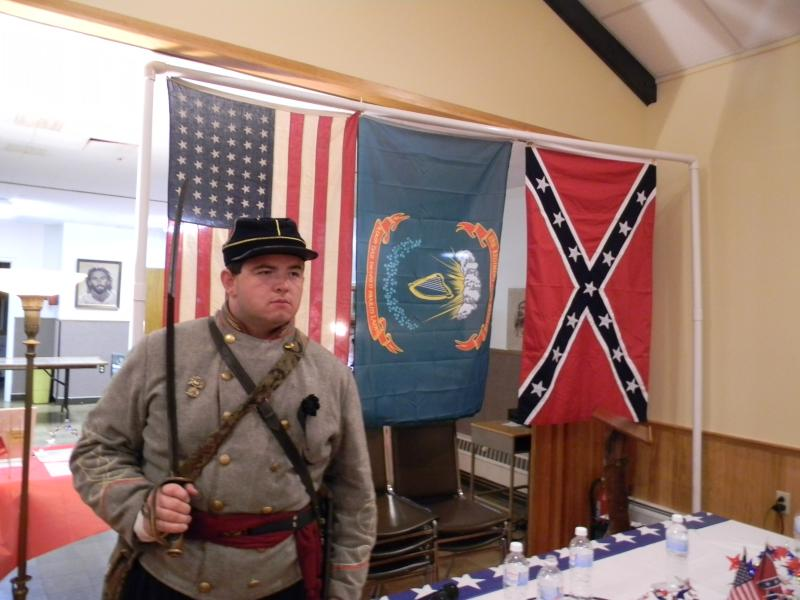 Wielding a Civil War era sword (crafted in 1864) along with his Confederate uniform, Brandon Adkins revels in telling strangers about how Town Line, New York seceded from the Union for 85 years.