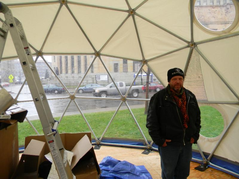 Occupy Buffalo resident John Rossman stands inside the encampment's new geodesic dome. (Click through to see exterior photo.)