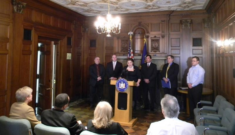 "Flanked by members of western New York's legislative delegation, the Labor Department's Rachel Demarest Gold announces NY Youth Works, a program incentivizing businesses to hire ""at risk"" 16 to 24 year olds."