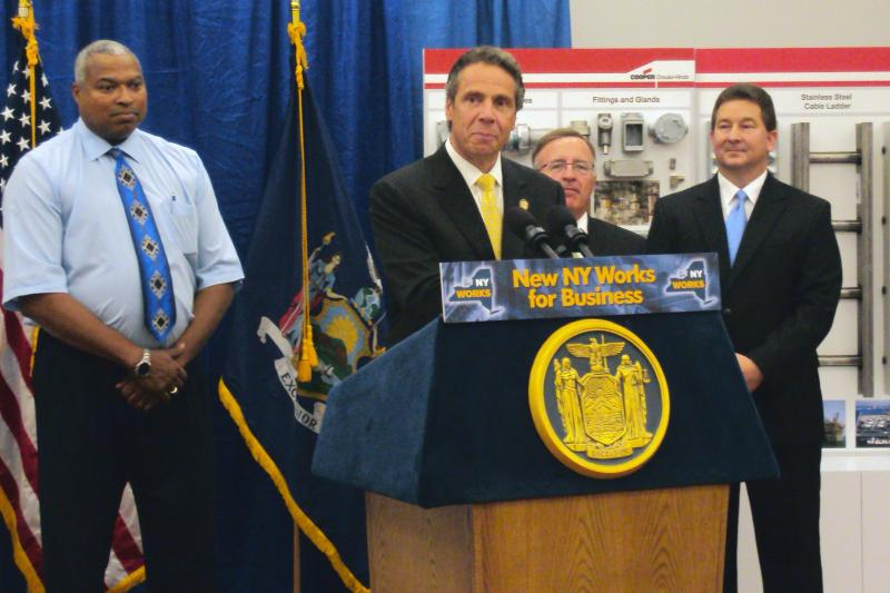 Gov. Andrew Cuomo speaks to the media and employees at Cooper Crouse-Hinds following a site tour in Syracuse.