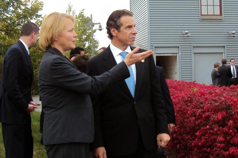 Gov. Andrew Cuomo listens to Onondaga County Executive Joanne Mahoney at the Inner Harbor Tuesday in Syracuse.