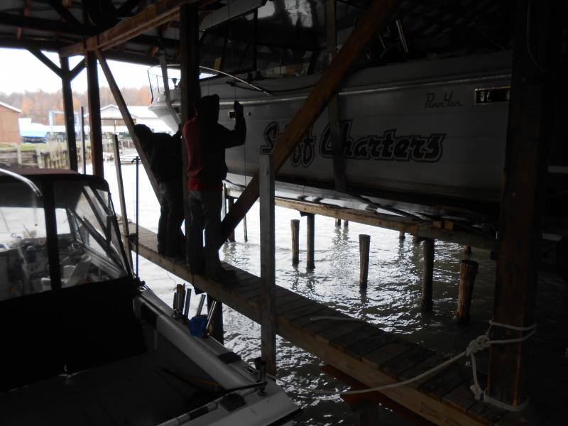 North country marinas brace for surge on lake ontario for Boat garage on water