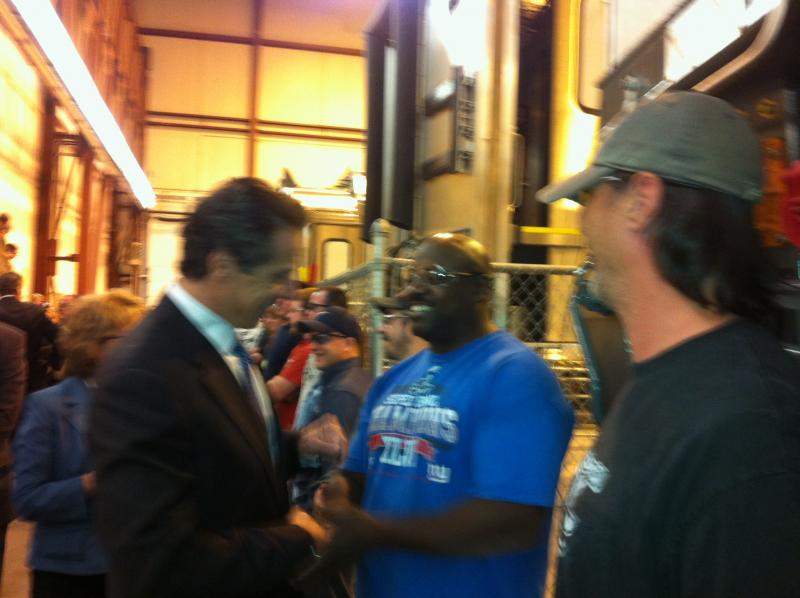 The governor shakes hands with Bombardier employee Mitchell Graham